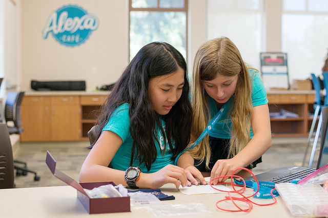 girls work on wearable electronics project