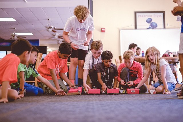 students race SparkFun RedBot at DMA camp