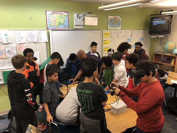students testing out VR