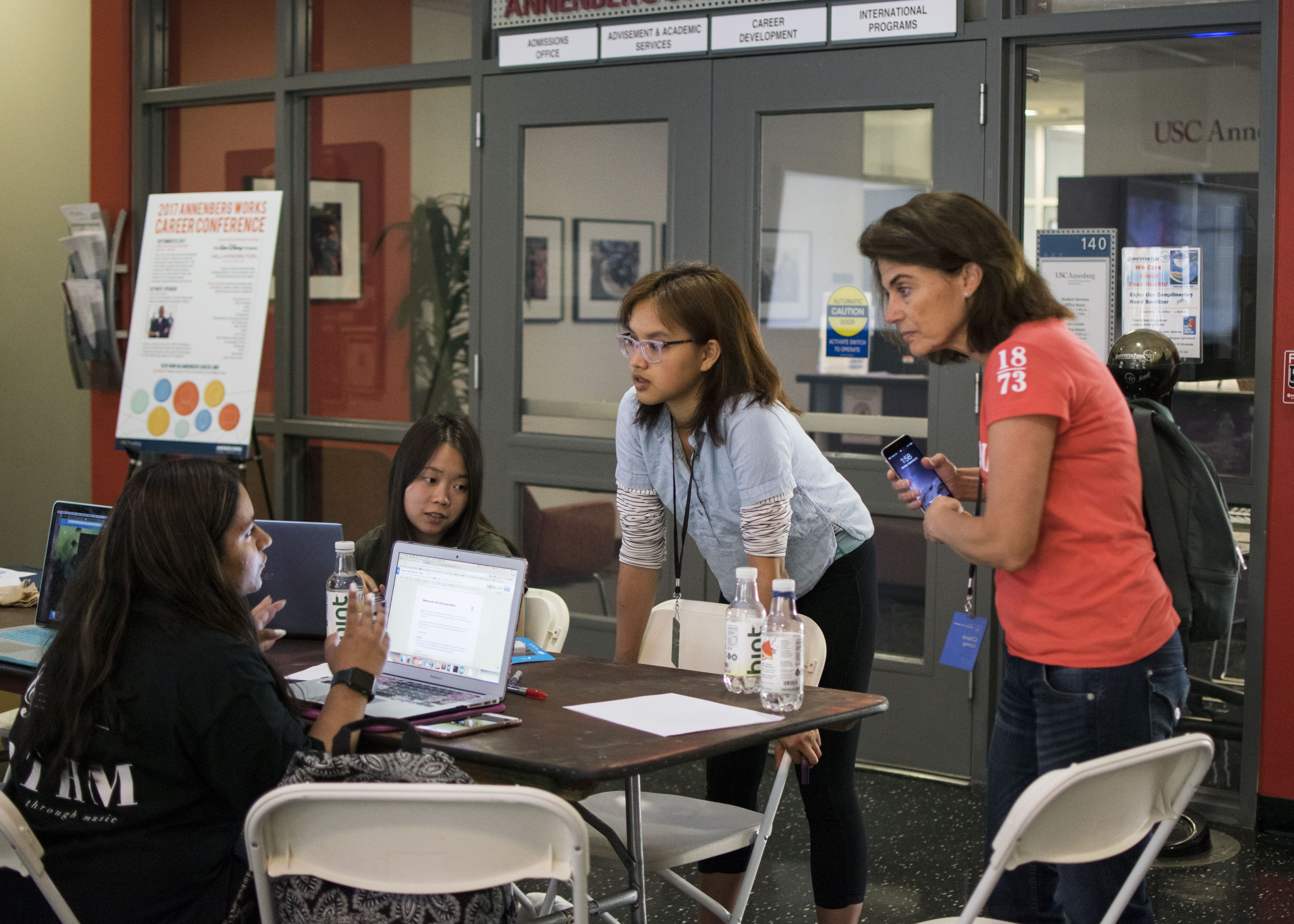 women working together at Break to Make hackathon