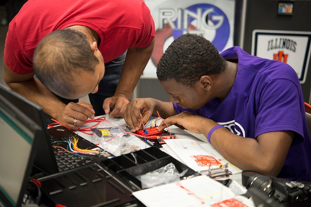 working on electronics together