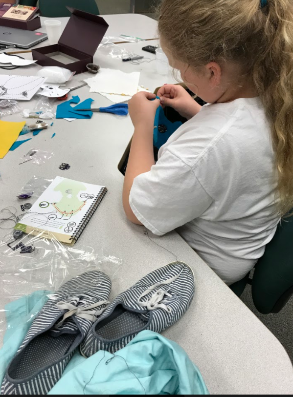 student working on e-textile project