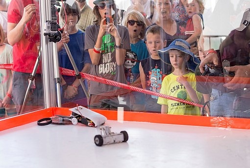 Students watch the combat bots competition at SparkFun's AVC