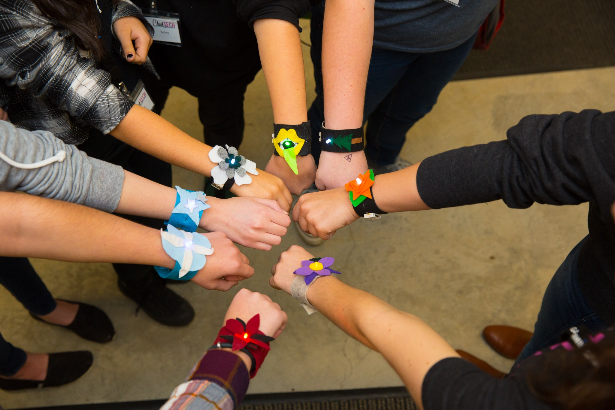 students show off their soft circuit bracelets