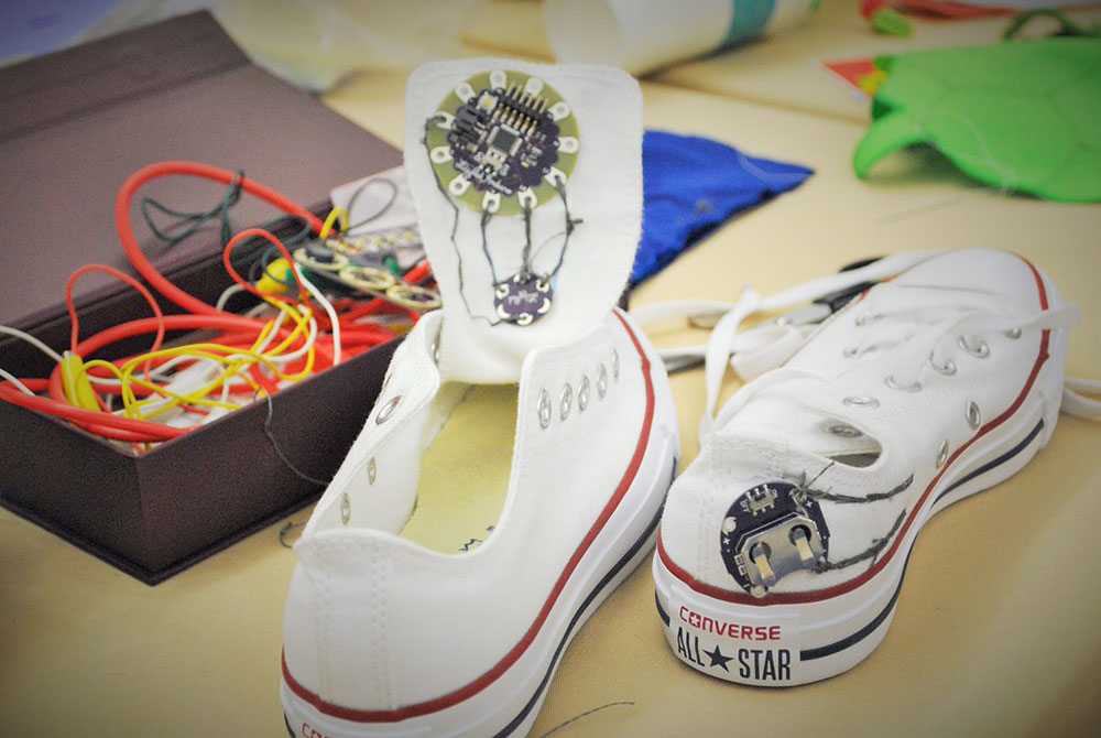 Sneakers that light up in the dark built with a LilyPad Simple Board and LilyPad Light Sensor