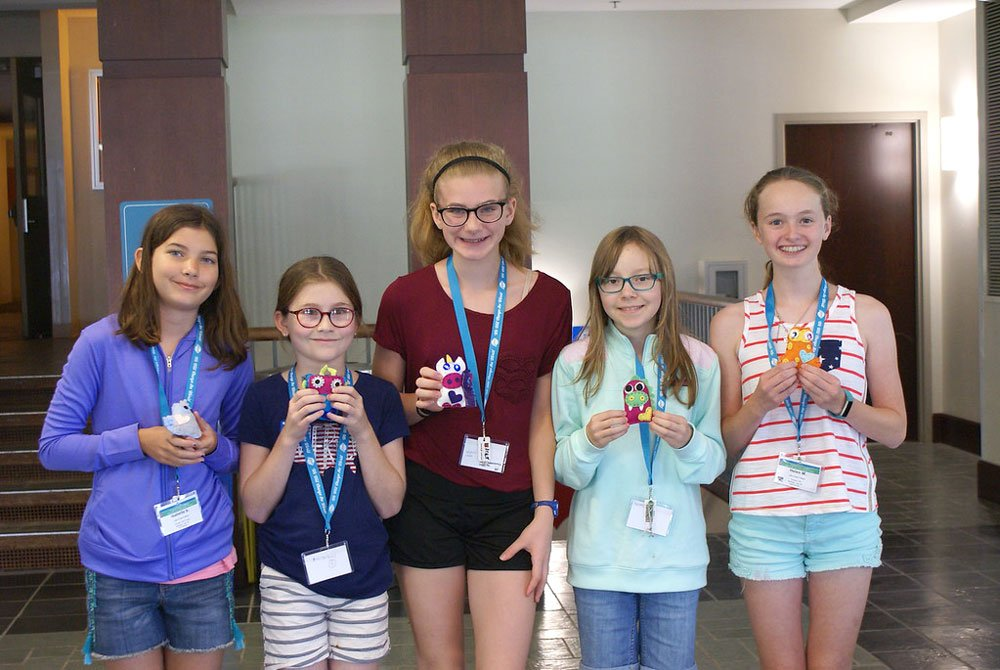 Five Alexa Cafe students holding their plush projects