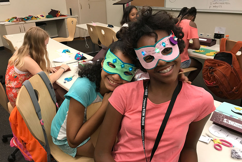 Made-by-Girls participants pose wearing light up masks