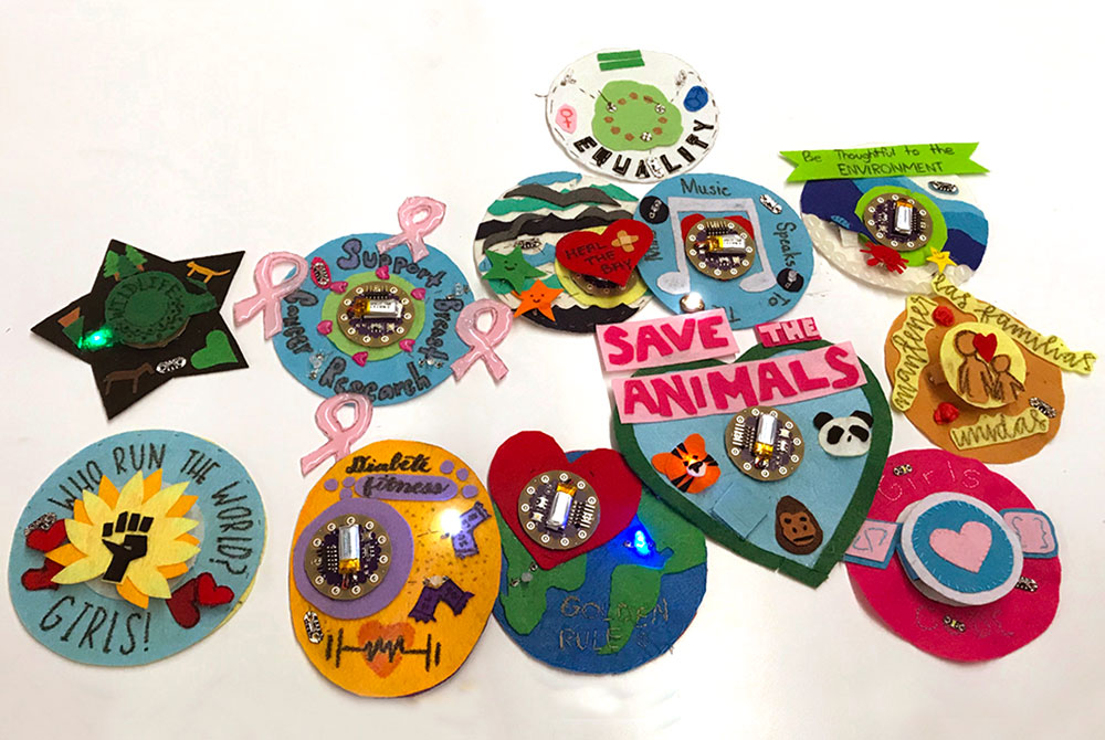 E-textile badges made with LilyPad Arduino on a tabletop.