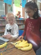 students playing banana piano